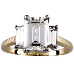 2.32 Carat Emerald Cut Diamond 14 Karat Yellow Gold Three-Stone Engagement Ring