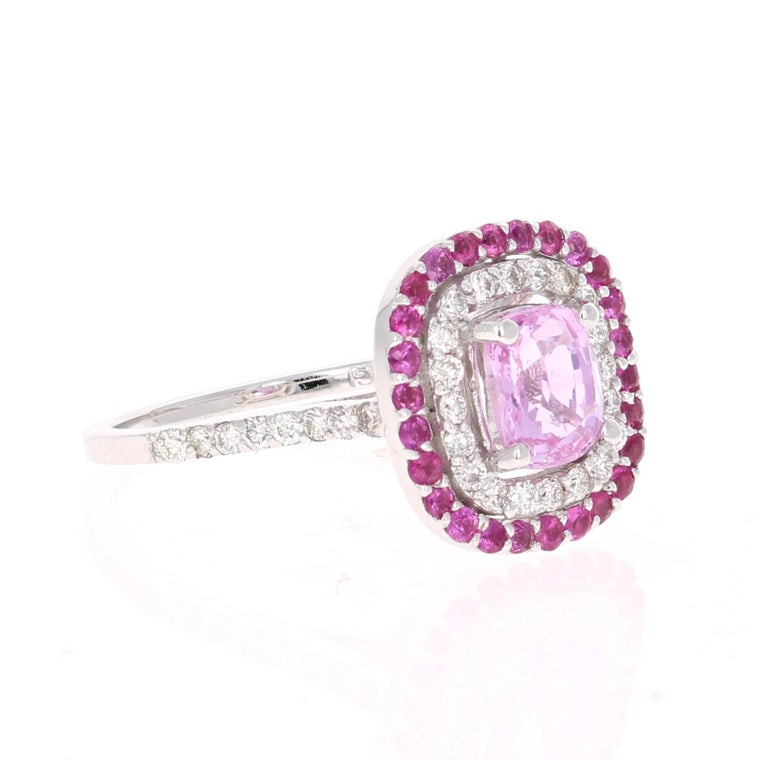 Simply the most elegant and beautiful Pink Sapphire and Diamond Engagement or Wedding Ring!  The center Cushion Cut Pink Sapphire is 1.47 Carats and is surrounded by a halo of 36 Round Cut Diamonds with a carat weight of 0.41 Carats (Clarity: VS,