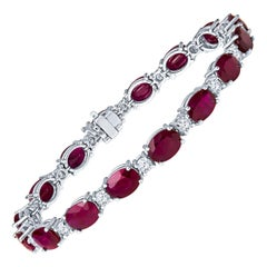 23.27 Carat Oval Ruby and 2.04ct Round Diamond 14kt White Gold Tennis Bracelet