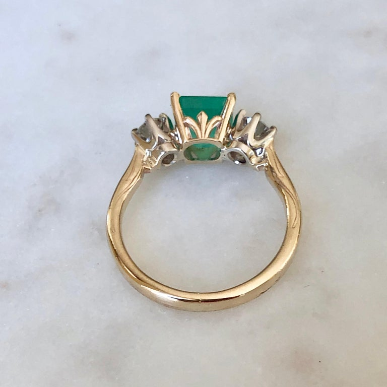 Stunning 2.33 Carat Natural Colombian Emerald & Old European Diamond Engagement Ring 14K Natural Colombian Emerald, Emerald Cut, Color/Clarity : Medium Light Green/ Clarity VS. Total Emerald Weight : 1.58 carat (7.1mmx7.0mm). Second Stone: Diamonds