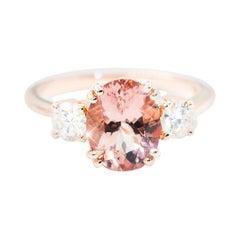 2.33 Carat Oval Morganite 0.53 Carat Diamond 18 Carat Gold Three Stone Ring