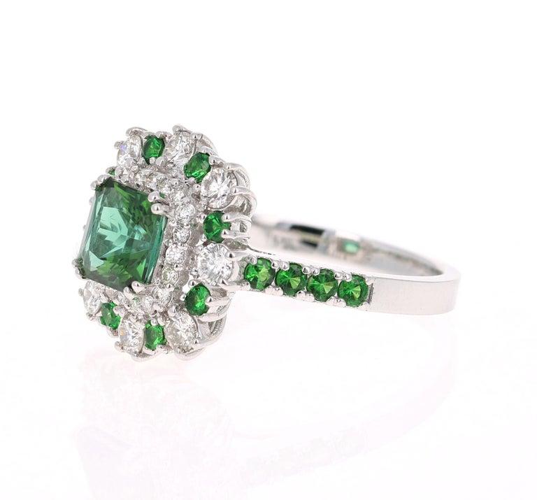 Modern 2.33 Carat Tsavorite and Diamond 18 Karat White Gold Engagement Ring For Sale