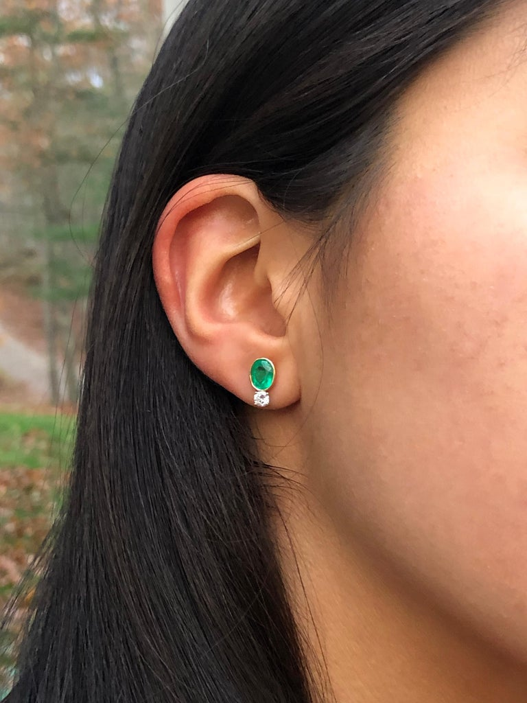 2.35 Carat Natural Colombian Emerald Diamond Stud Earrings 18k  Primary Stones: 100% Natural Colombian Emeralds Shape or Cut : Oval Cut Average Color/Clarity : Beautiful AAA+ Medium Green/ Clarity, VS Total Weight Emeralds: Approx. 2.00 Carats (2