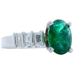 2.35 Carat Oval Emerald and Baguette Diamond Platinum Cocktail Ring