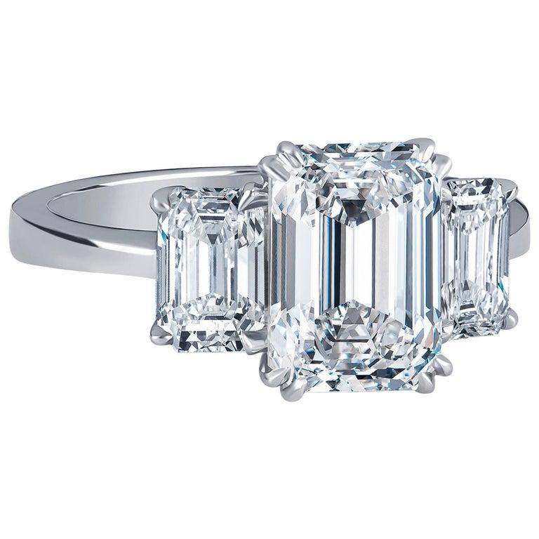 2.36 Carat D VVS2 'GIA' Emerald Cut Diamond, 1.02 Carat Sides, 3-Stone Ring For Sale