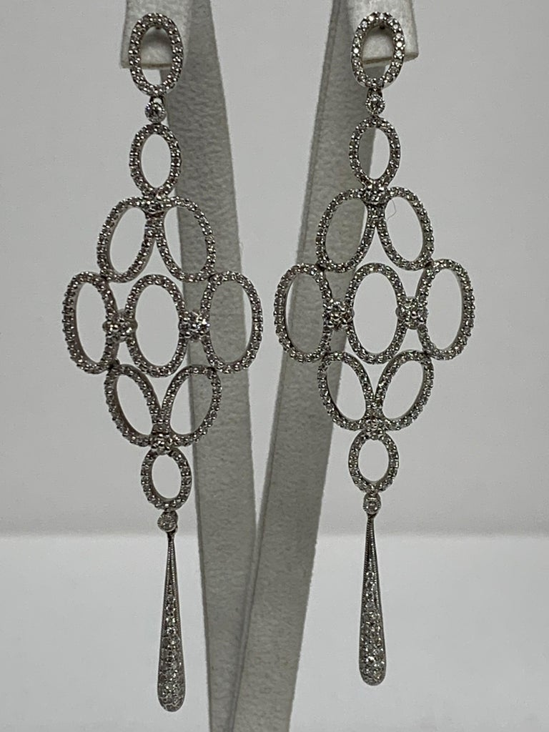 Art Nouveau Hand Crafted and Custom Designed one-of-a-kind Earrings.  These striking earrings will be the finishing touch you are looking for, on that special night out.  Pave Diamonds 2.36CT 18KT White Gold  We specialize in unique, one-of-a-kind,