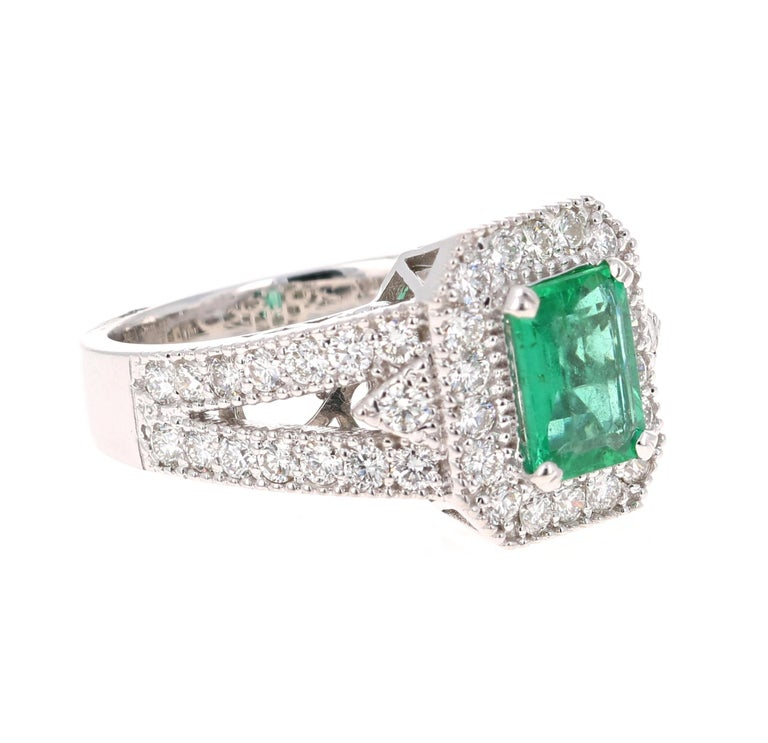 Stunning Vintage Inspired Emerald Cut Emerald Diamond Ring!   This Emerald ring is absolutely gorgeous. The center is an Emerald Cut Emerald which weighs 1.17 carats and measures in at 6mm x 8 mm. The Emerald is GIA Certified, GIA Cert Number: