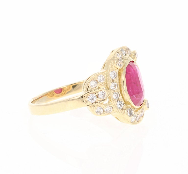 Simply beautiful Ruby Diamond Ring with a Oval Cut 1.76 Carat Ruby which is surrounded by 30 Round Cut Diamonds that weigh 0.63 carats. The total carat weight of the ring is 2.39 carats. The clarity and color of the diamonds are VS-H.   The ring is