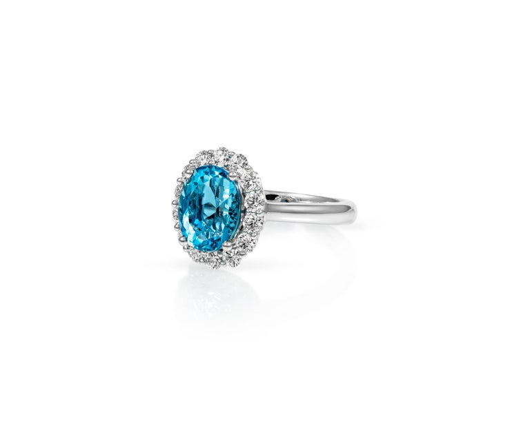 Beautiful 2.3ct Oval Aquamarine surrounded by .85ct Diamonds on 18kt White Gold. With the highest quality materials and vintage-inspired design, this ring will make you feel like you're a royal in the Renaissance Age. Only one available.