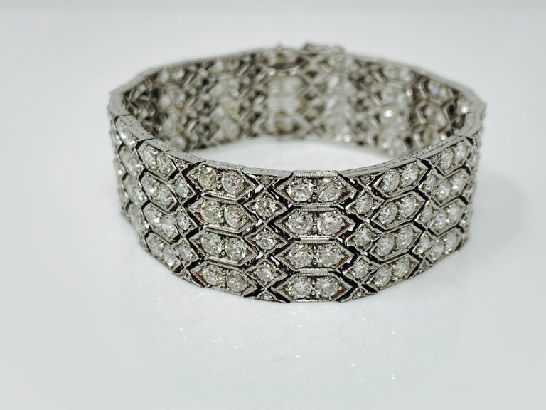 This Antique fabulous one of a kind white diamond wide bracelet is handmade and is from 1920's.  Diamond weight : 24 carat with GH color and VS - SI clarity.  Measurements : 7 inches long and .75 inch wide.