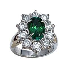 2.4 Carat Oval Tsavorite & 2 Carat Diamond in 18 Karat White Gold Ring Estate