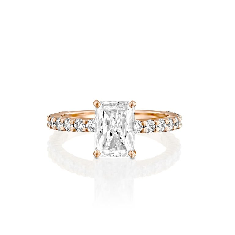 This impressive ring features a solitaire GIA certified diamond. Center stone is 100% eye clean natural, radiant shaped 1.5 carat diamond of F-G color and VS2-SI1 clarity and it is surrounded by smaller natural round diamonds of 0.90 total carat