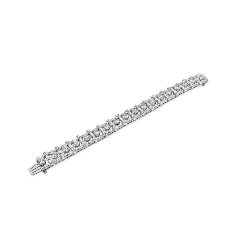 An important diamond bracelet showcasing 18 round brilliant diamonds weighing 12.50 carats total, set in an open-work box setting accented with baguette and round diamonds. Accent diamonds weigh 11.50 carats total. Made in platinum.