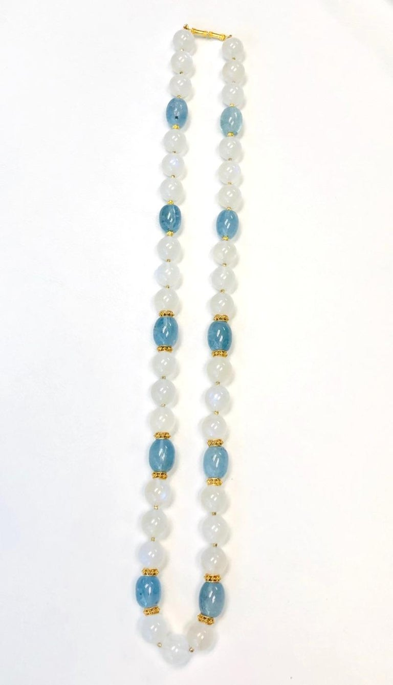 Soft aquamarine blue and dreamy moonstone gemstone beads come together to create this extremely beautiful necklace! Measuring 24 inches in length, this strand features 10 large, barrel-shaped aquamarine beads and 33 large, round rainbow moonstone