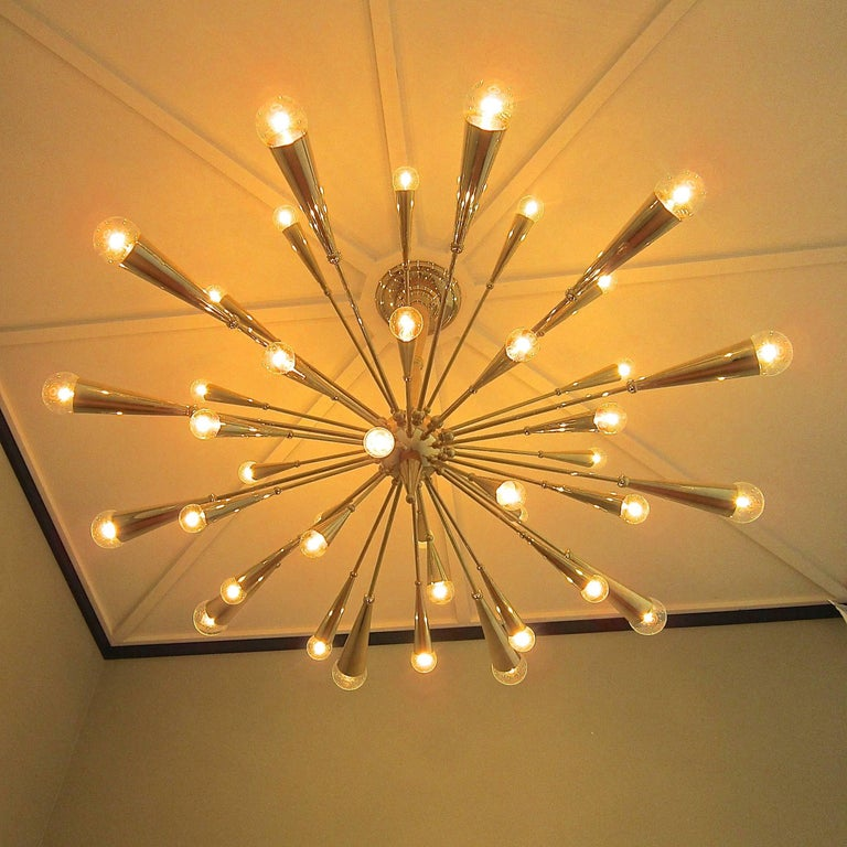Custom-made 24-karat gold plated brass Sputnik chandelier over 5 feet wide.  66 inches in diameter including lightbulbs. 32 inches height but we can lengthen or shorten by request.  40 arms and 40 lights total. 12 up, 16 down and 12 extra large