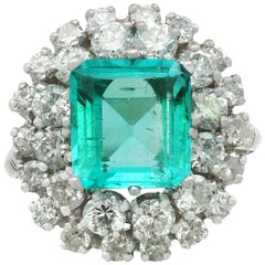 2.42 Carat Emerald 1.62 Carat Diamond White Gold Cluster Ring, circa 1950