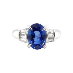 2.43 Carat Sapphire and Tapered Diamond Ring Set in Platinum