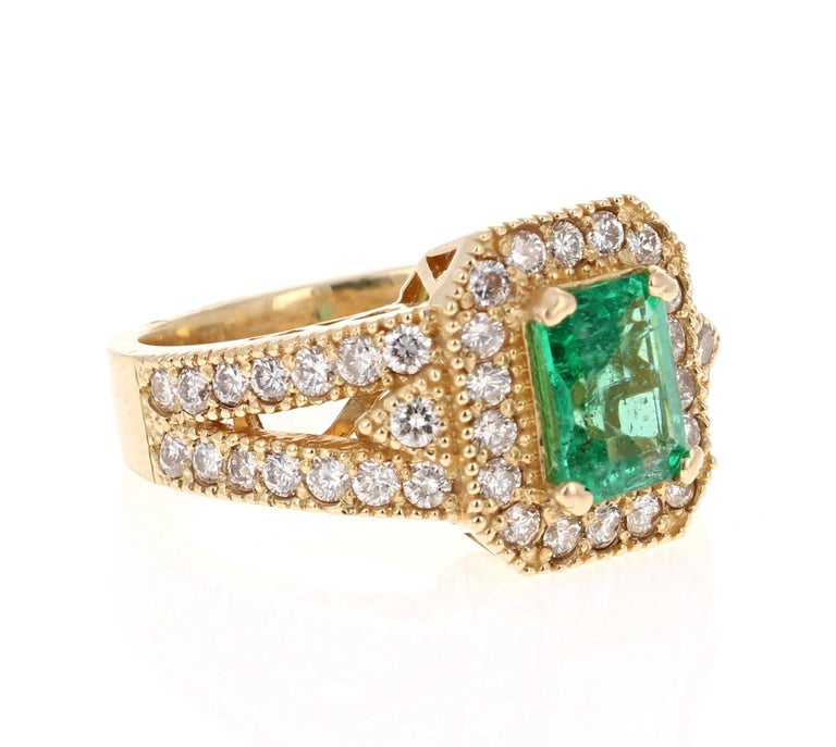 Stunning Vintage Inspired Emerald Cut Emerald Diamond Ring!   This Emerald ring is absolutely gorgeous. The center is an Emerald cut Emerald which weighs 1.24 carats and is surrounded by 48 Round Cut Diamonds weighing 1.20 carats (Clarity: SI1,