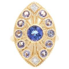 2.44 Carat Natural Tanzanite and Diamond 14 Karat Solid Yellow Gold Ring