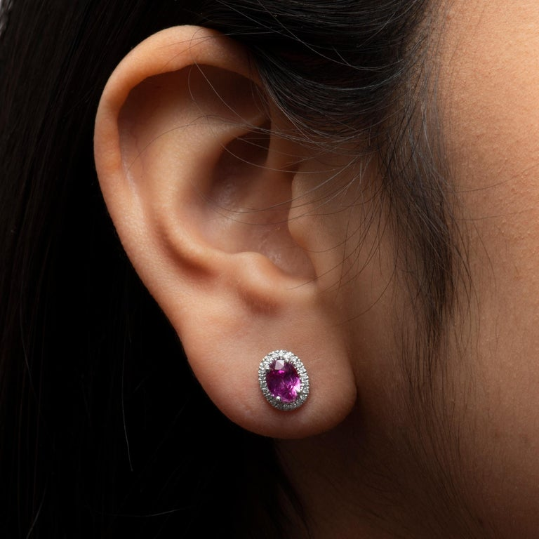 Oval Cut 2.44 Carat Total Oval Natural Pink Sapphire Stud Earrings with Diamond Halos For Sale