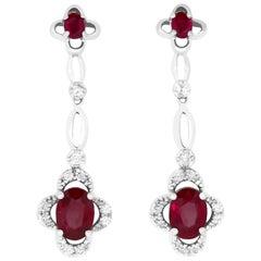 2.45 Carat Oval Ruby and 0.28 Carat Diamond Earrings