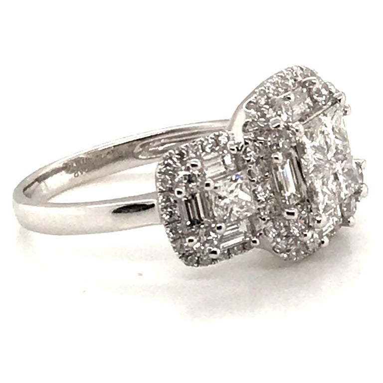 HJN Inc. Ring featuring a Princess Cluster Diamond Ring With Baguettes and Rounds  Baguette-Cut Diamond Weight: 0.78 Carats Princess-Cut Diamond Weight: 0.96 Carats Round-Cut Diamond Weight: 0.71 Carats  Total Stones: 86 Clarity Grade: SI1 Color