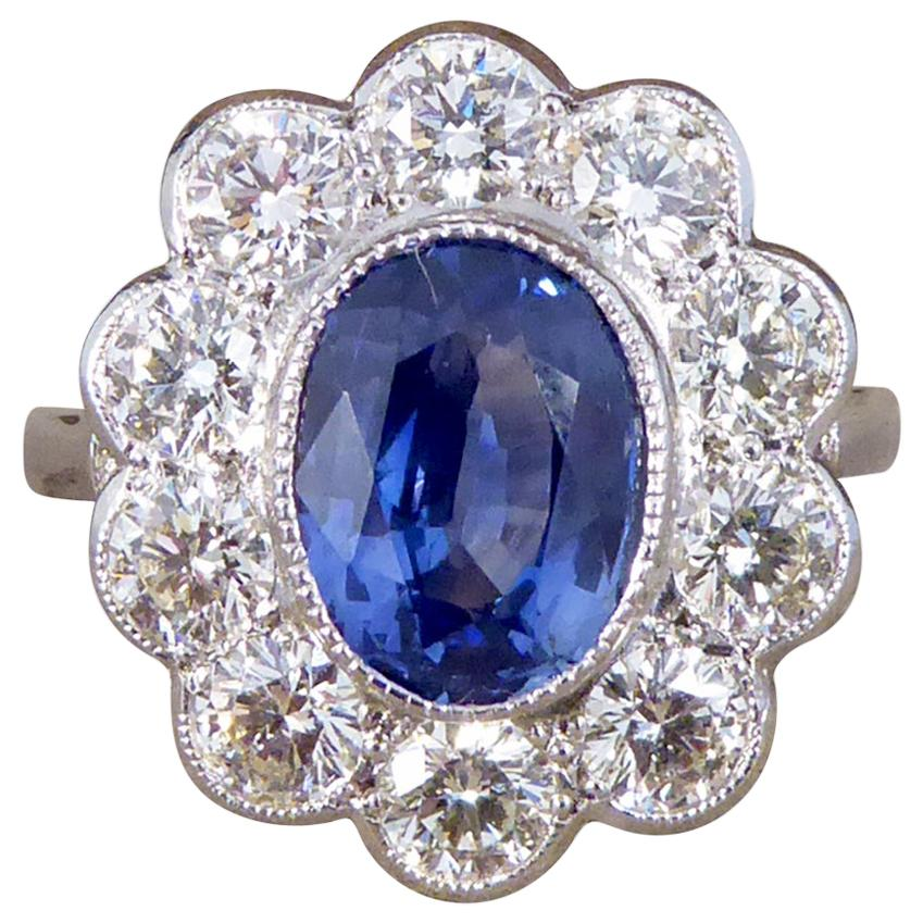 2.45 Carat Sapphire and 1.60 Carat Total Diamond Cluster Ring in Platinum