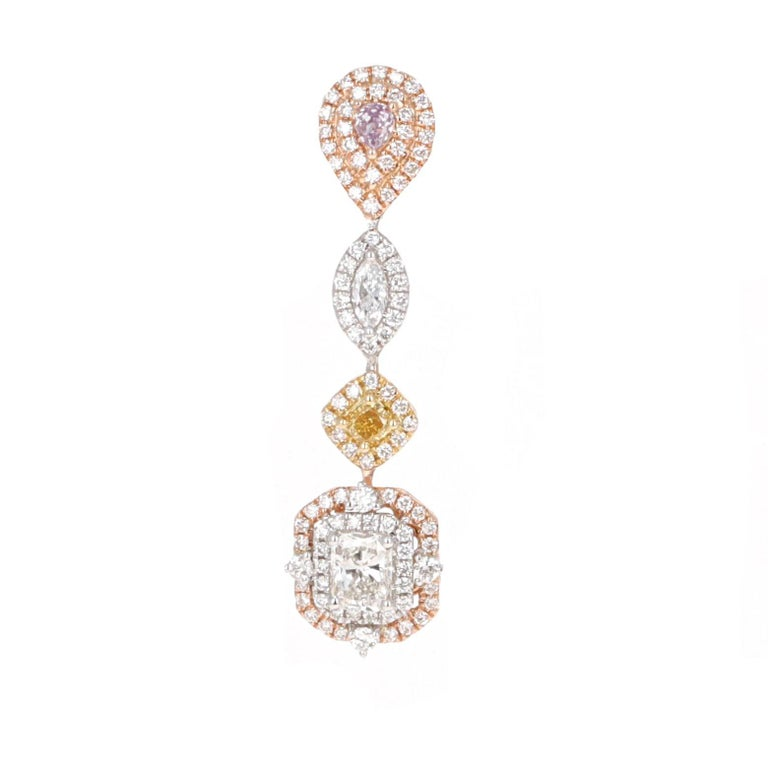 These dangle drop earrings are made with all natural fancy colored diamonds and fancy shaped diamonds. They are very trendy and fashion forward. The colors are very bold and bright. They are made with 18 karat yellow, white and rose gold.  The total