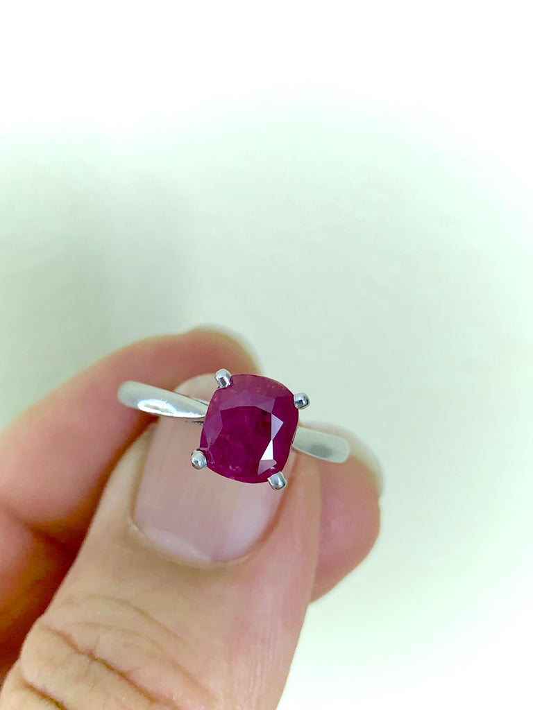 A classic natural ruby engagement ring. Set with one cushion shape old cut natural untreated ruby in a prong setting open back with a weight of 2.48 carats. A classic solitaire design solid 950 platinum settings. Currently a US size 6:25 and easily