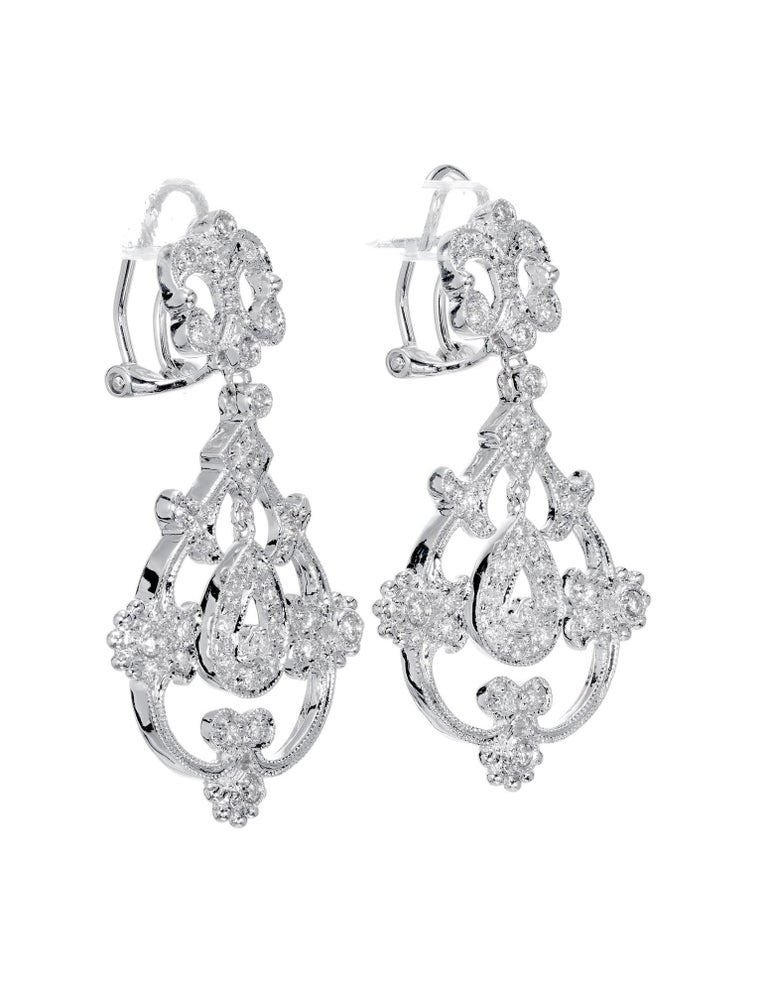 Open work diamond post clip dangle earrings. Set in 14 white gold with 62 round full cut diamonds.  62 full cut round diamonds. approx. total weight .25cts Length: 1.36 inches or 34.61mm Width: .81 inches or 20.68mm 7.4 grams 14k white gold