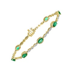 2.5 Carat Emerald And  Diamond Tennis Bracelet 14 Karat Yellow Gold