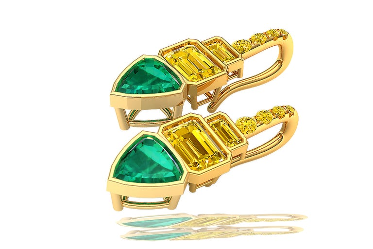 A stunning pair of rare and vivid yellow diamond earrings can be seen here.  The drop earrings are made of trillion cut emeralds that have a rich green color and are eye clean.  The emeralds weigh between .65 to .85 carats each.  The emeralds are