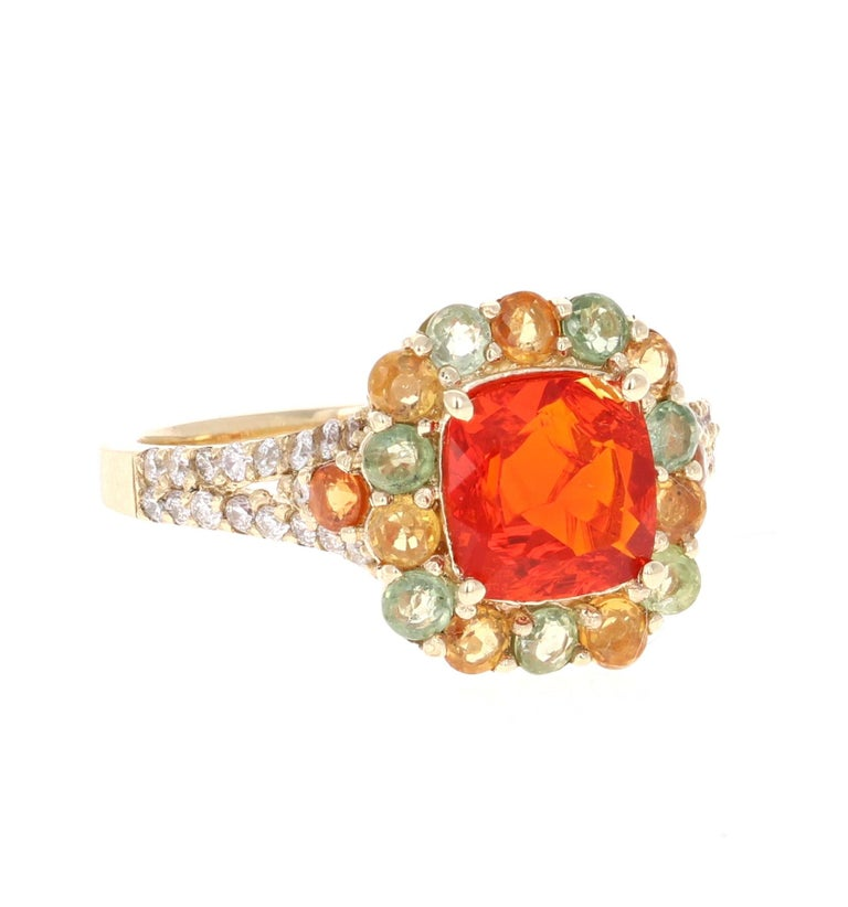 Beautiful 2.50 Carat Fire Opal, Multi-Sapphire and Diamond Cocktail Ring!   This uniquely designed Ring has a 1.04 carat Cushion Cut Fire Opal in the center of the ring which is surrounded by 16 Round Cut Multi-Colored Sapphires in hues of Orange &