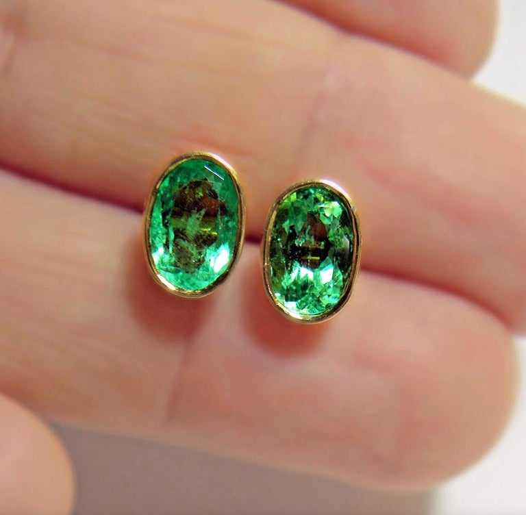 2.50 Carat Natural Colombian Emerald Oval Stud Earrings 18k Yellow Gold Primary Stones: 100% Natural Colombian Emeralds Shape or Cut : Oval Cut Average Color/Clarity : Gorgeous AAA+ Medium Green/ Clarity, VS  Total Weight Emeralds: Approx. 2.50