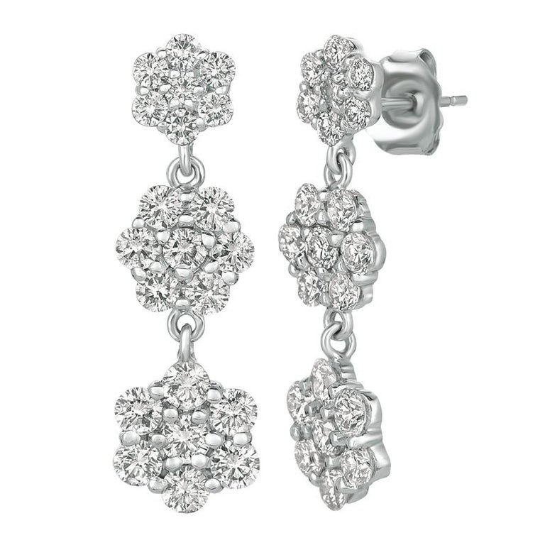 2.50 Carat Natural Diamond Earrings G SI 14K Yellow Gold      100% Natural, Not Enhanced in any way Round Cut Diamond Earrings     2.50CT     G-H      SI       14K Yellow Gold,  4.4 grams, Prong     1 inch in height, 5/16 inch in width     42