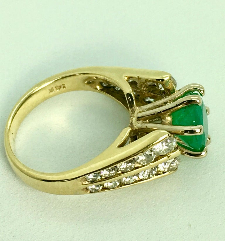Stunning Estate 2.50 Carats Natural Colombian Emerald Solitaire Ring Diamond Accents Shape or Cut: Round  Emerald Weight: 1.50 Carats (1 emerald)  Color: Natural FINE Medium-Light Green  Accent Stones: Diamond G-VS-SI1  Approx 1.0 Carat This