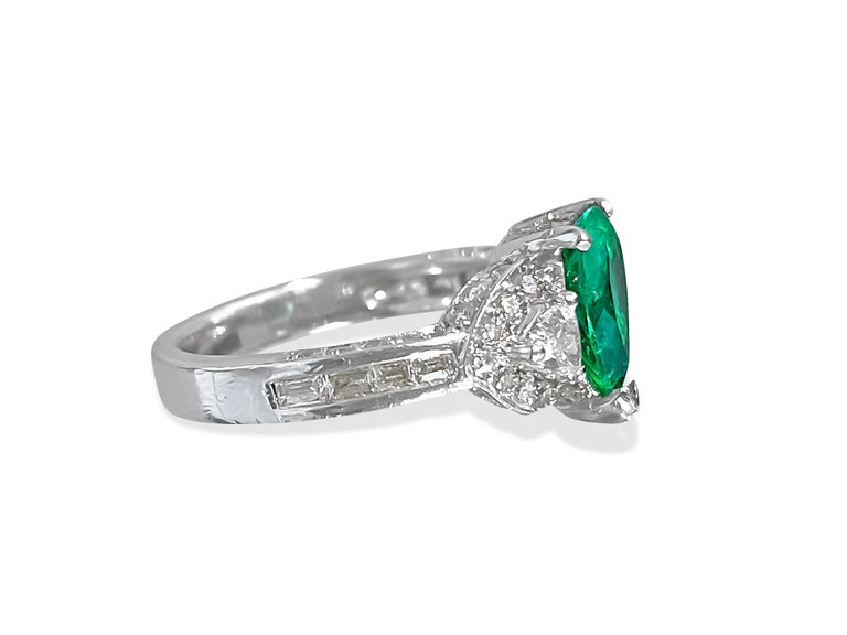 Metal: 18K white gold.  2.50 carat Colombian emerald. 100% natural earth mined. Pear shaped emerald set in prong setting.   1.00 carat diamond, trillion cut diamonds. Designer vintage emerald and diamond ring.  Ring size: US 6.25 Free ring resizing