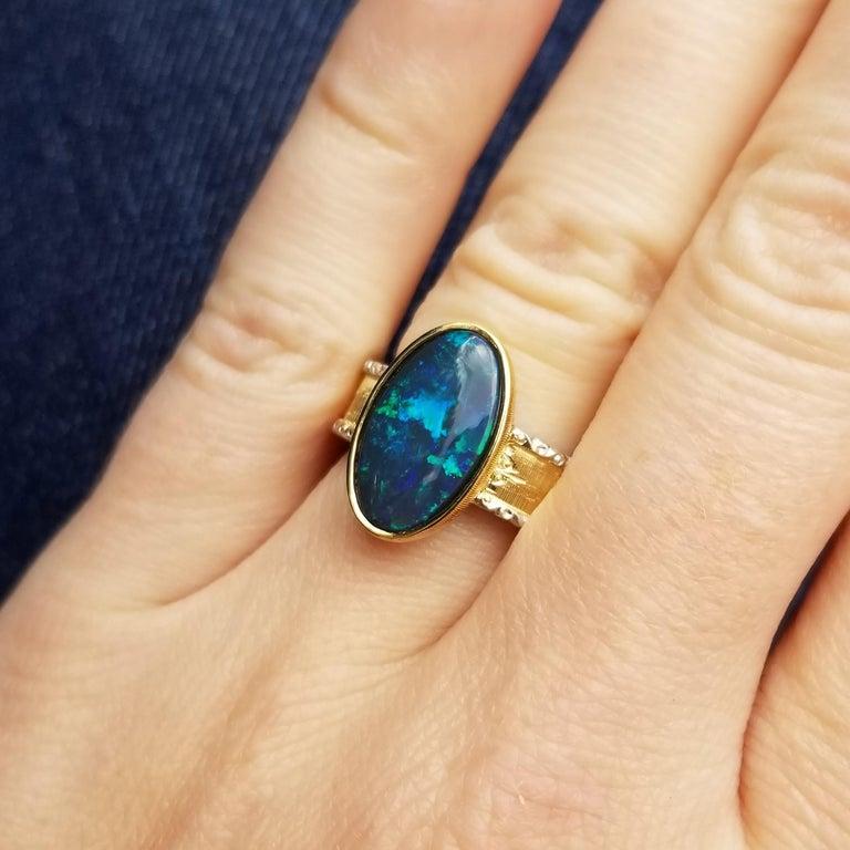 Oval Cut 2.51 Carat Australian Black Opal in 18 Karat Hand Engraved Italian Ring For Sale