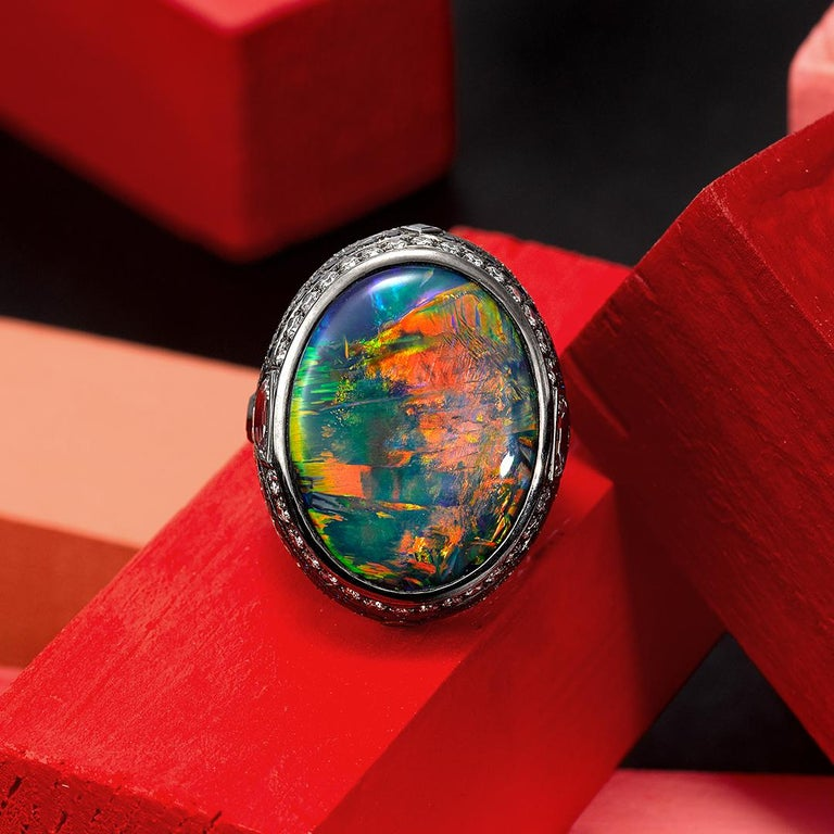 This one of a kind Ring features a very special 25.10ct lighting ridge Black Opal of exceptional quality (GSL certified), 142 white Diamonds weighing 3.24ct (color D / F clarity VS2) and 48 blue Sapphires weighing 0.97ct all set into 18ct white gold