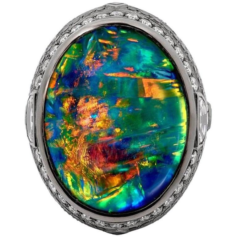 25.10 Carat Lightning Ridge Black Opal 0.97 Carat Blue Sapphires Diamond Ring For Sale