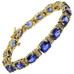 25.25 Carat Tanzanite and Diamond Tennis Line Bracelet 14 Karat Yellow Gold