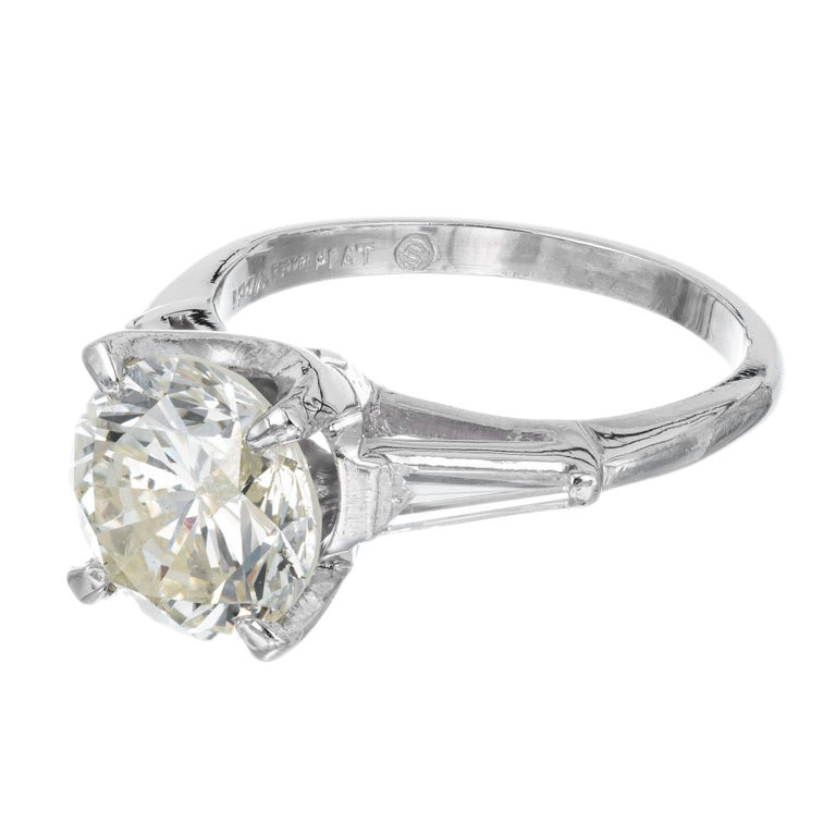 2.53 Carat Round Cut Baguette Diamond Three-Stone Platinum Engagement Ring In Good Condition For Sale In Stamford, CT