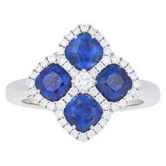 2.53 Carat Sapphire and Diamond Ring, 18 Karat White Gold Halo