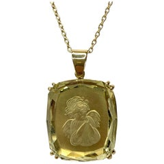 25.49 Carat Golden Beryl Carved Guardian Angel Intaglio Yellow Gold Pendant