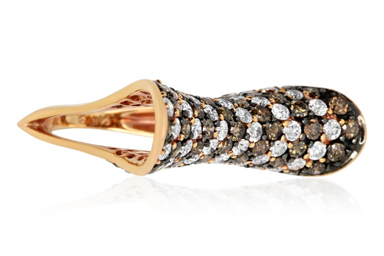 We couldn't wait to create this bold design! This fabulous ring features alternating rows of 2.55 Carats of brilliant Natural Cognac color Diamonds and 2.06 Carats of White Diamonds all of SI clarity and H-I color. Guaranteed to be a show stopper,
