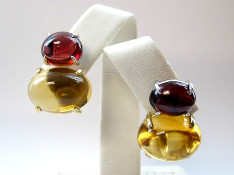 These striking earrings feature very large, golden citrine cabochons and burgundy-red garnet cabochons in a classic, warm color combination. Both the citrine and garnets are extremely clean and transparent, which is unusual for cabochons. Handmade