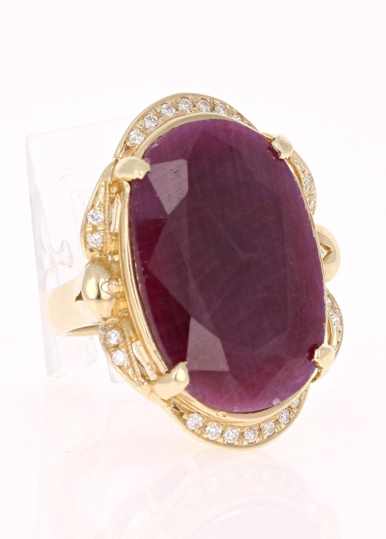This ring is truly a one of a kind beauty!   There is a large Oval Cut Ruby set in the center of the ring that weighs 25.31 carats.   It is surrounded by 23 Round Cut Diamonds that weigh 0.28 carats.   The total carat weight of the ring is 25.59