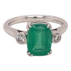 2.56 Carat Cushion Cut Emerald and Diamond Three-Stone Ring in 18k White Gold