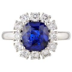 2.59 Carat Blue Sapphire with .72 Carat Diamond Halo