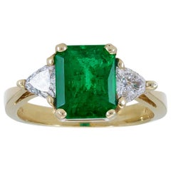 2.59 Carat Green Emerald and Trillion Diamond Three-Stone Engagement Ring